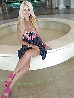 Mature businesswoman posing naked in public