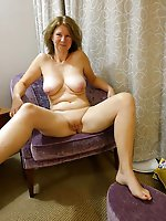 Mad older damsel spreading her legs on photo