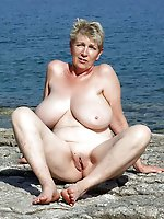 Sexual older MILF posing almost naked on photo