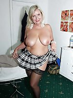 Mature mistress posing undressed in public
